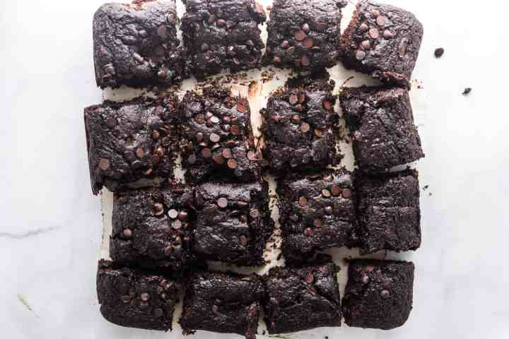 9 pieces of zucchini brownies cut up with chocolate chips on top