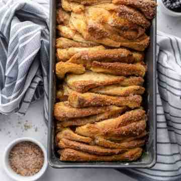 Pull apart cinnamon bread in loaf pan over kitchen towel