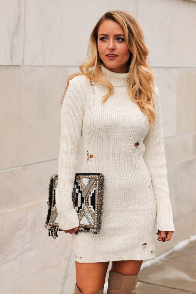 amber from every once in a style is wearing a forever 21 sweater dress with a beaded clutch