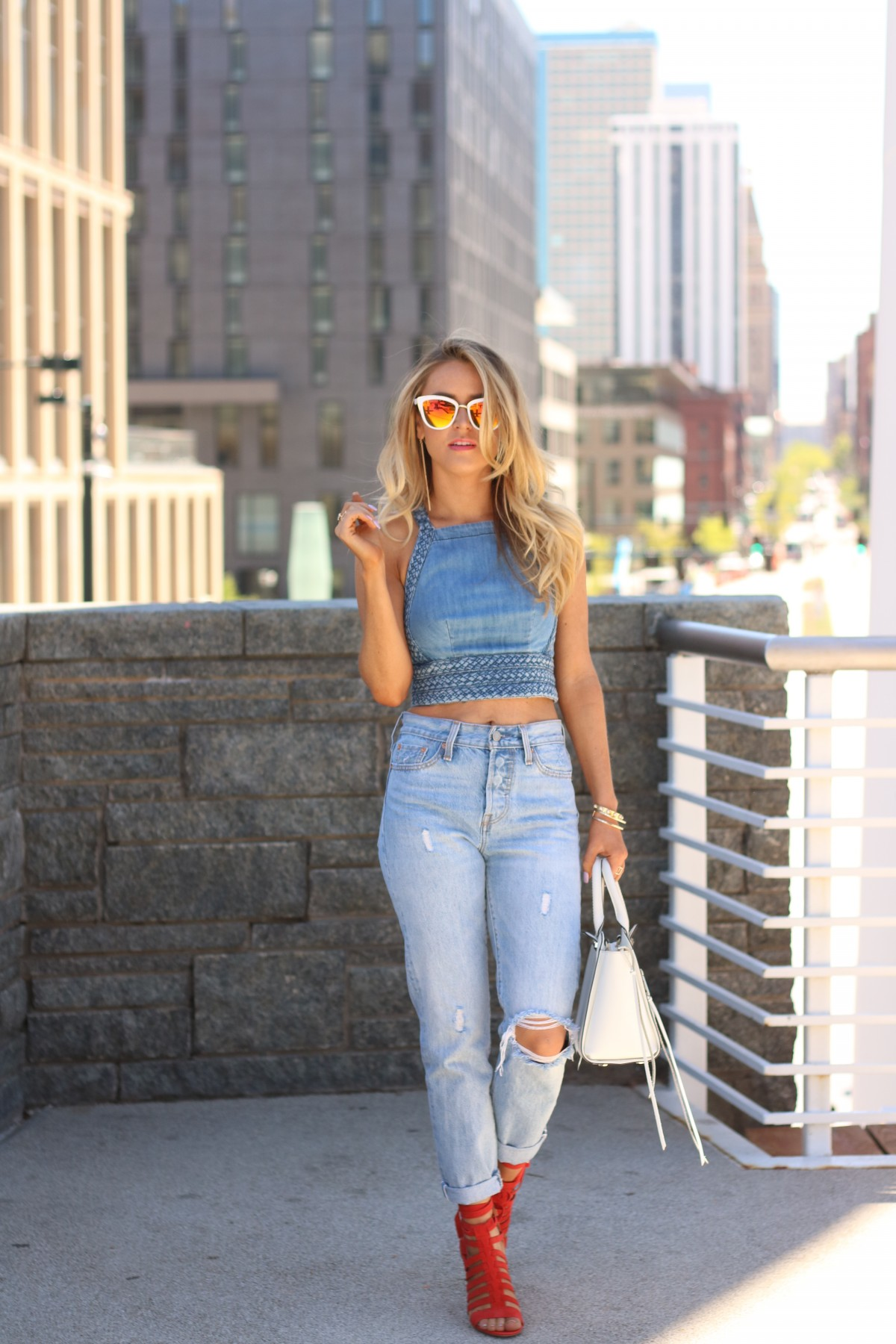 amber from every once in a style wearing   Levi's 501   denim crop top