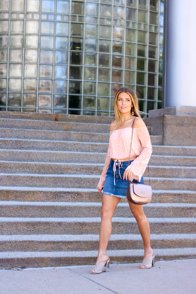 amber from every once in a style wearing | off the shoulder lace top | denim mini skirt | rose gold bag | slide sandals