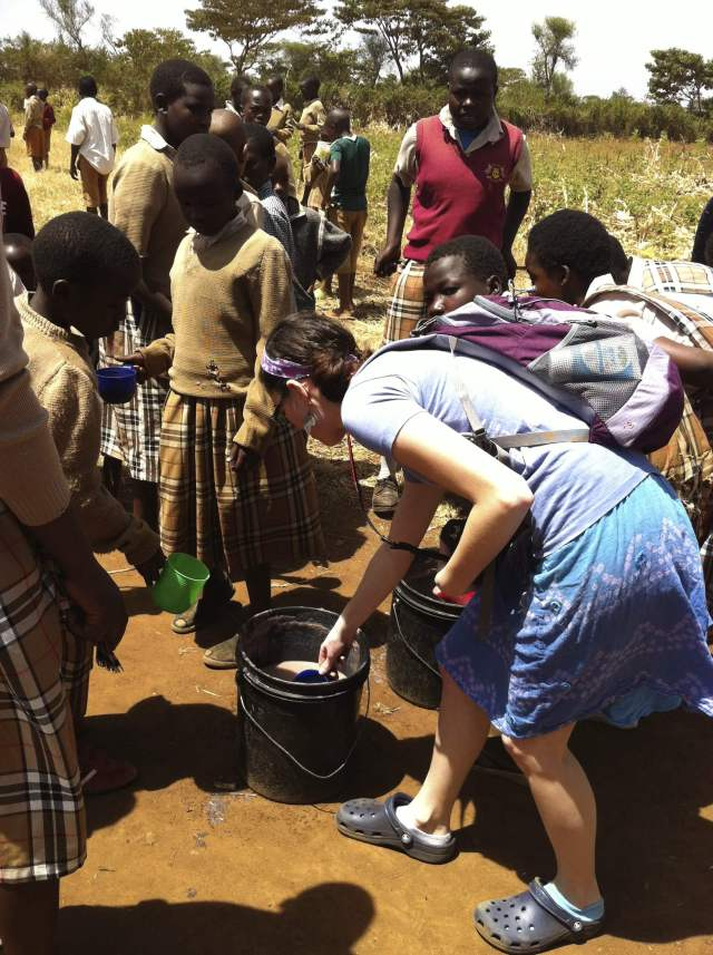 Autumn Benjamin helps out with the orphan lunch program in Kampi Ya Moto