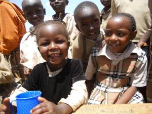 Children receiving their lunch in Kampi Ya Moto, Kenya