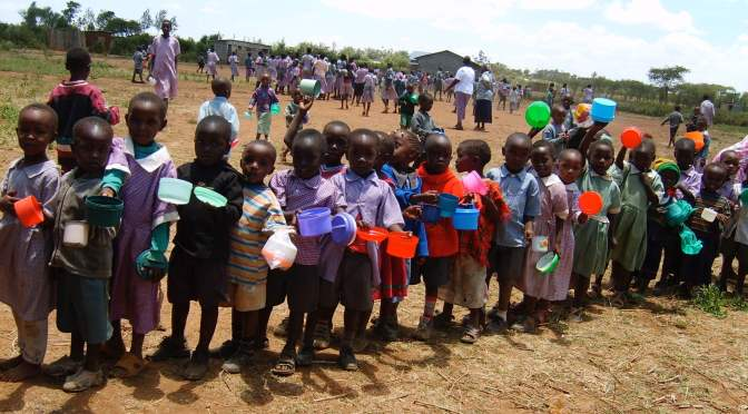 children waiting for their meal in Kenya