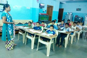 a classroom full of boys learning
