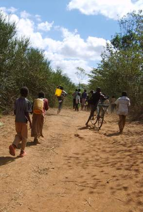Carrying maji or water from the river in Kampi Ya Moto< Kenya