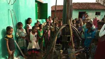 Quenching the thirst of children in India - Waiting by the drill and watching for water