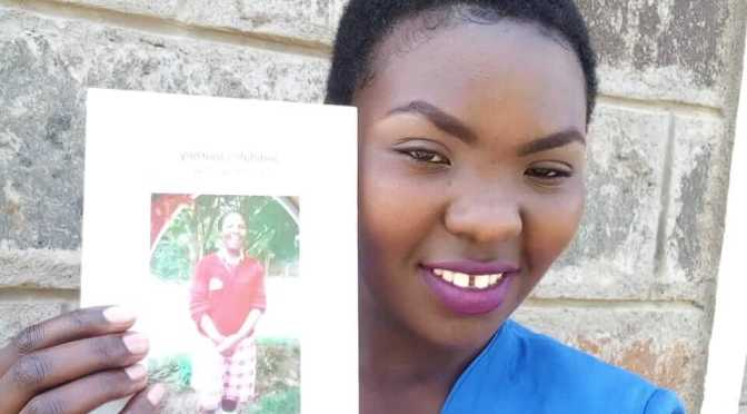 Jedidah with a copy of Jedidah's Journey