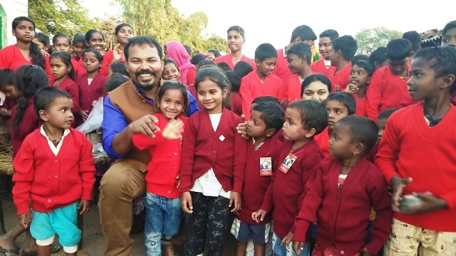 Everyone's Child Now in India: children receiving a new sweater in India