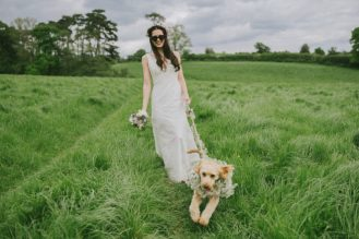 Bride with her cockerpoo who looks like he has had enough for the day.