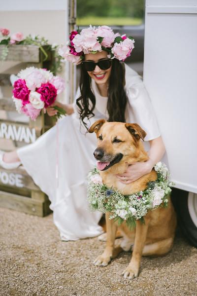 Bride posing with her Shepherd cross