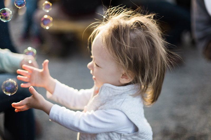 baby chasing bubbles