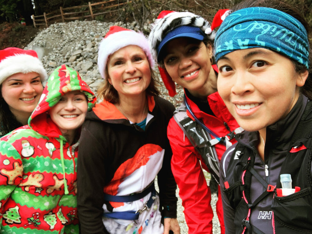 Selfie of 5 female trail runners in holiday wear