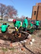 Volunteers from Comcast Cable kicks off the start of garden season with their annual volunteer day, Comcast Cares Day