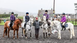 Lucinda Fredericks with ponies