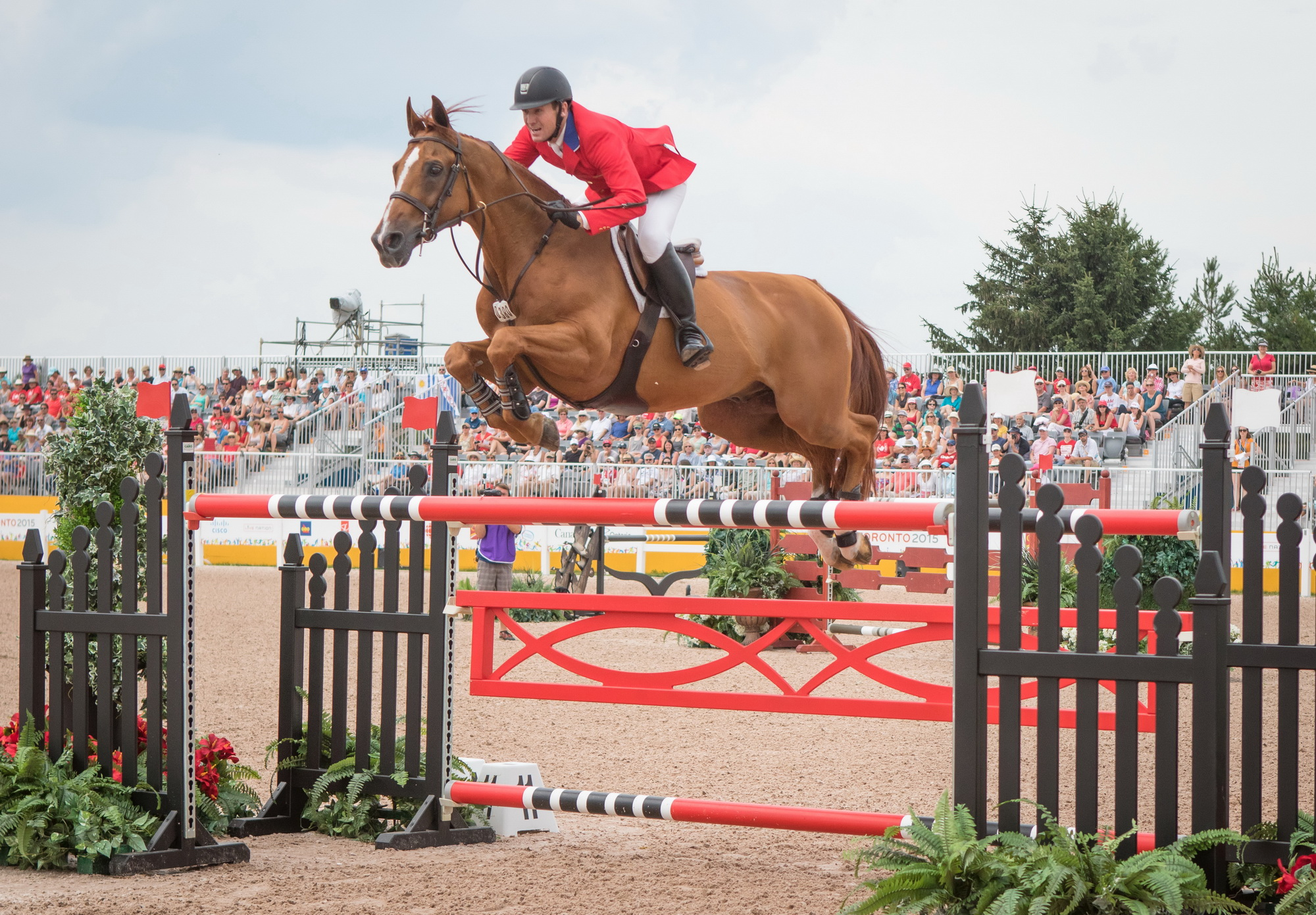 Two-time Olympic gold medallist McLain Ward (USA), the new world number one in the Longines Rankings, is pictured here with stallion Rothchild at the OLG Caledon Pan Am Equestrian Park during the Toronto 2015 Pan American Games in Caledon, Ontario (CAN) (FEI/Eric Knoll)