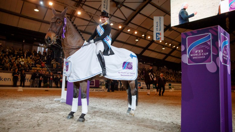 """Look at me - I just won!"" Isabell Werth's Don Johnson FRH knows he's the centre of attention after topping today's seventh leg of the FEI World Cup™ Dressage 2016/2017 Western European League at Neumunster (GER). This was the German rider's fourth victory in the current series. (Stefan Lafrentz/FEI)"