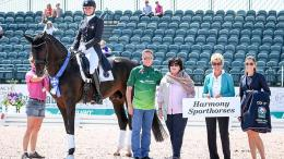 Adrienne Lyle and Salvino in their winning presentation with Allyn Mann of Adequan®, Betsy Juliano, judge Ulrike Nivelle, and Cora Causemann of AGDF.