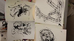 Series of inked up pages ready for paint.
