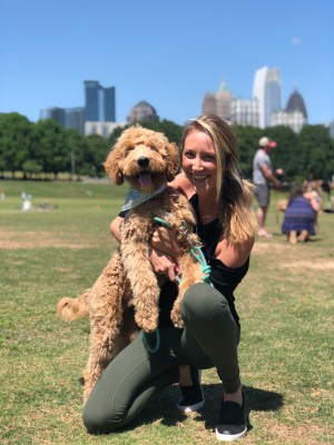 Caty Leslie With Her Goldendoodle at Park