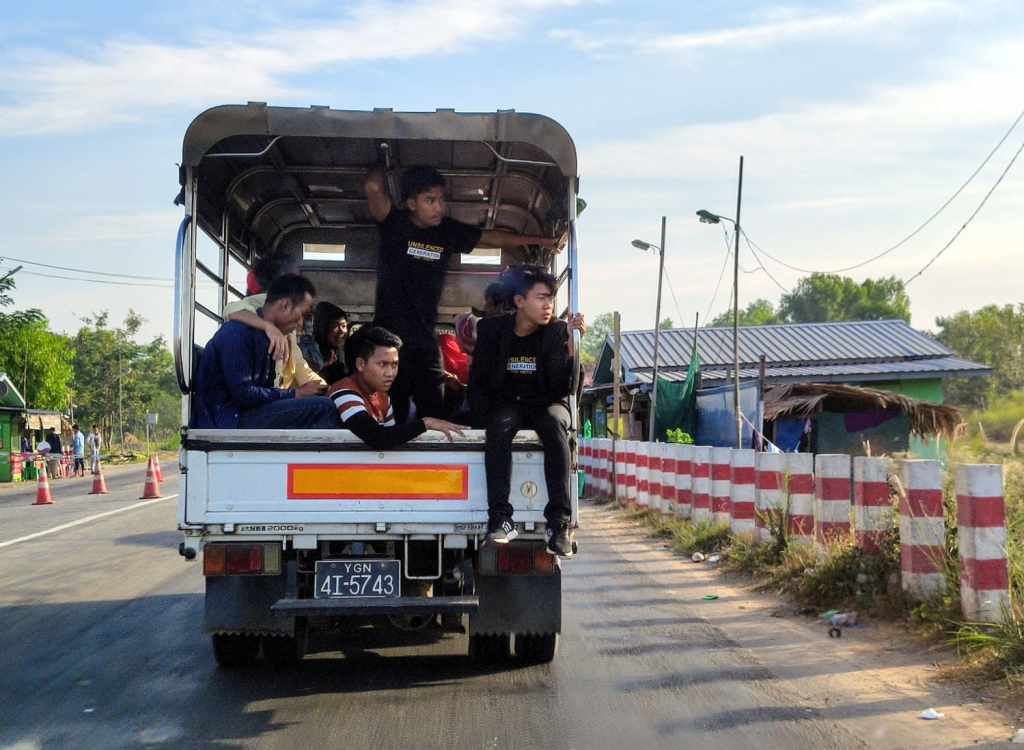Young burmese people on a truck