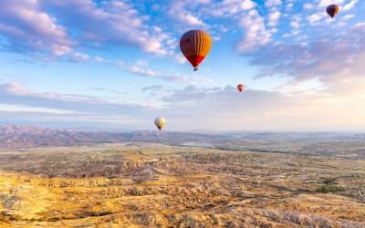 CAPPADOCIA – Flying a hot air balloon into the sunrise