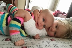 toddler and infant sisters