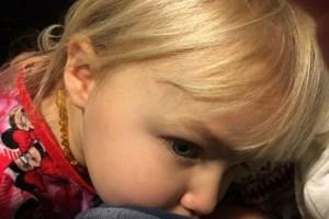 little girl nursing
