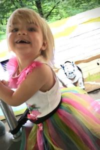 little girl on caurosel
