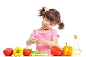 little girl prepping salad