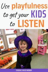 happy cooperative little girl in Halloween costume