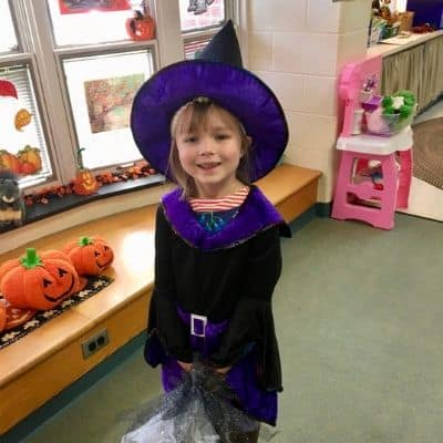 girl in cute witch costume