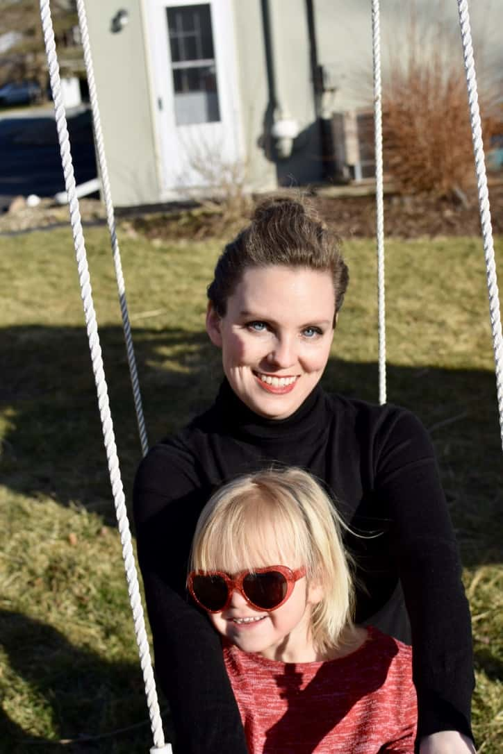mother swinging with girl