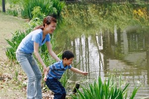 Mother and son at pond