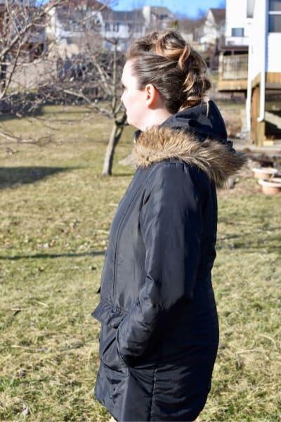 woman in Modern Eternity coat