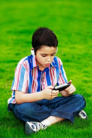 boy with handheld gaming system