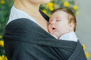 baby-sleeping-on-mother-in-wrap
