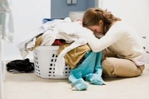 overwhelmed mom with laundry