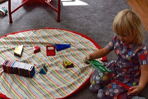 Little-girl-at-DIY-playmat-and-bag