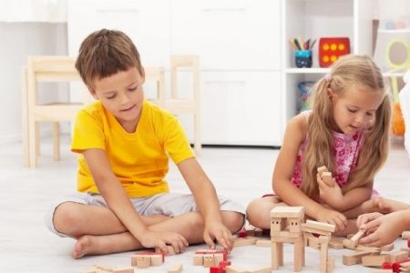 kids playing happily with wooden blocks