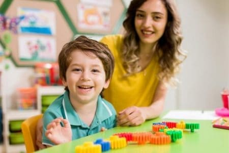preschooler happily playing with gears