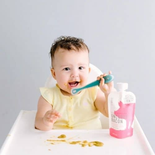 toddler eating serenity kids baby food with spoon