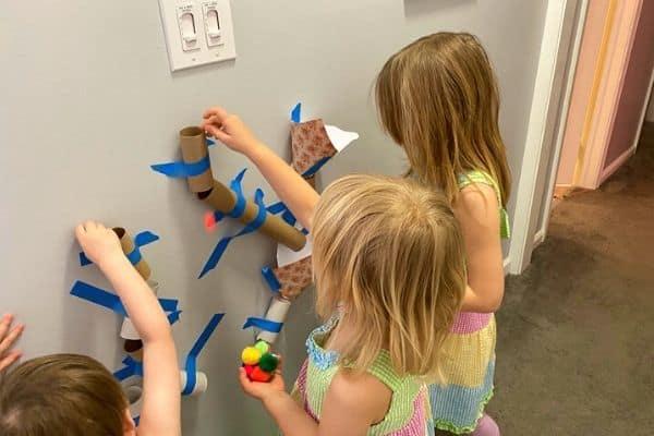 Kids playing with pom poms
