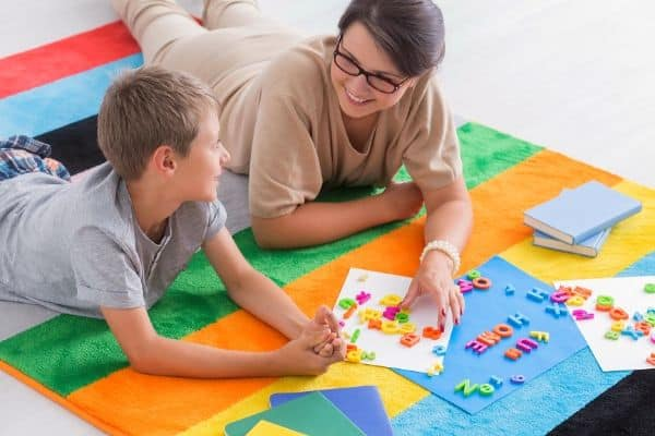 boy-and-mom-doing-puzzle-together