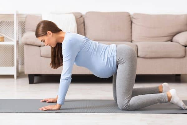 pregnant-woman-crawling-on-hands-and-knees