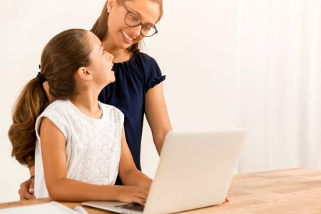 parent helping child with virtual learning