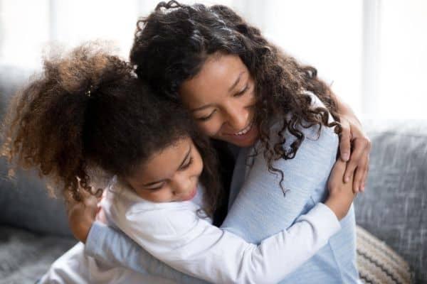mother hugging her little girl