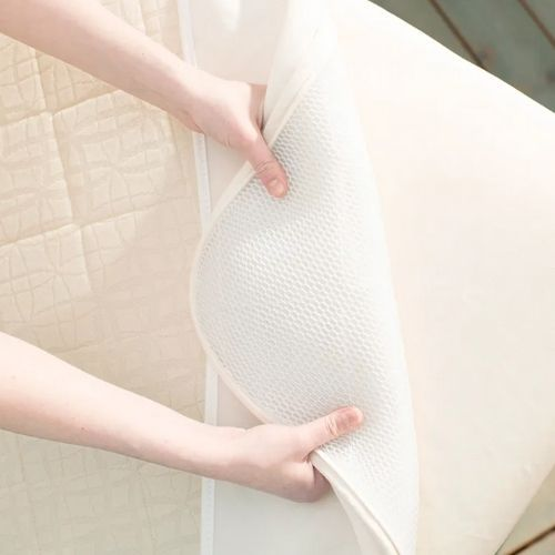 Honeycomb design in cotton cover makes the Ultra Breathable crib mattress from Naturepedic more breathable.