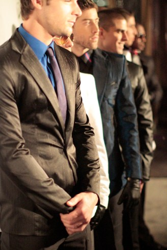 Men posing at a fashion show