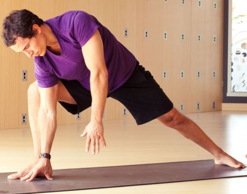 Man stretching on fittness mat